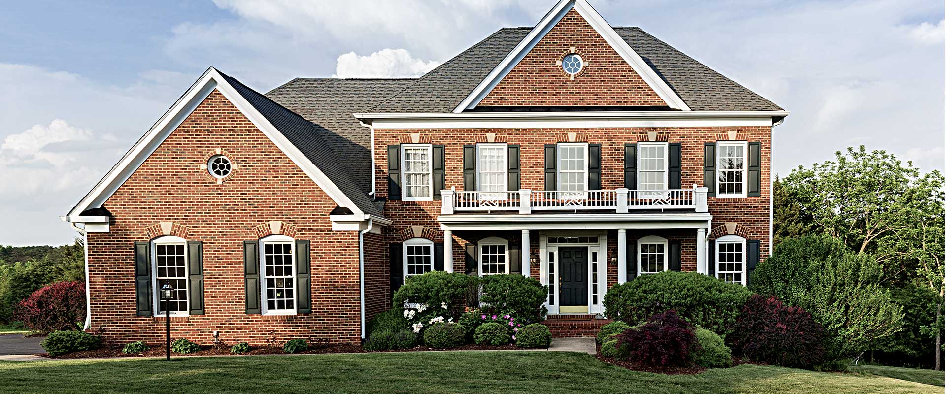 modern american colonial styled brick home
